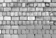 Alte Schwarzweiss-Backsteinmauerbeschaffenheit Stockbild