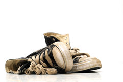 Alte Segeltuch-Turnschuhe oder laufende Schuhe Stockfotos