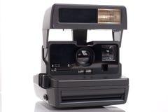 Alte sofortige analoge Filmkamera Stockbilder