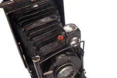Alte sofortige Kamera lokalisiert auf Weiß Stockfotos