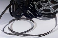 Alte Spule des Filmes und des Kinoklatschens Stockbilder