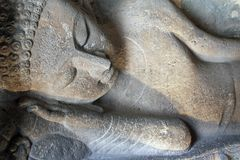 Alte Statue von stützendem Buddha Stockfotos