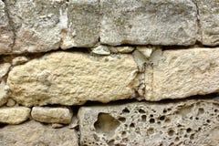Alte Steinmetzarbeit-Wand Stockfoto