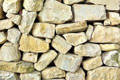 Alte Steinmetzarbeit-Wand Stockbild