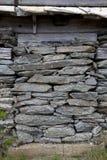 Alte Steinwand-Hintergrund-Beschaffenheit Stockfoto