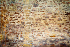 Alte Steinwand-Hintergrundbeschaffenheit Stockbild