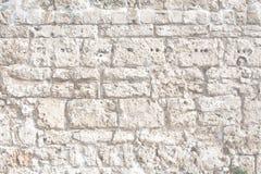 Alte Steinwand-Hintergrundbeschaffenheit Stockfotografie