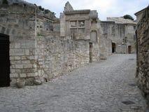 Alte Straße und Ruinen Stockbild