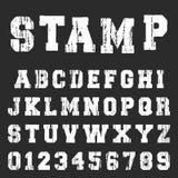 Alte strukturierte Alphabetgussschablone Stockfoto
