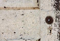 Alte Tür mit Schlüsselloch Stockbilder
