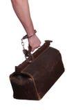 Alte Tasche geschützt mit der Handschelle Stockfoto