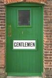 Alte Toilettentür Stockfoto