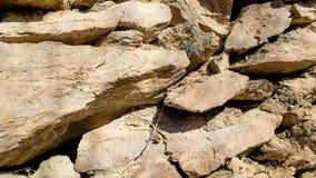 Alte Trockenmauerhintergrundzusammensetzung Stockbilder