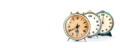 Alte Uhr auf Weiß Stockbilder