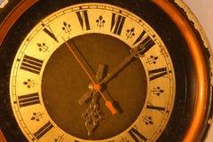 Alte Uhr mit den römischen Zahlen Stockbild
