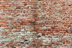 Alte und abgedroschene Backsteinmauer der roten Farbe Stockfotografie