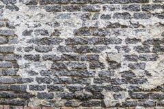 Alte und abgedroschene Backsteinmauer der schwarzen Farbe Stockfotografie