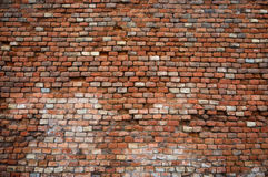 Alte und geschädigte Backsteinmauerbeschaffenheit Stockfotos