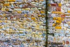 Alte und mehrfarbige Wand Stockbild