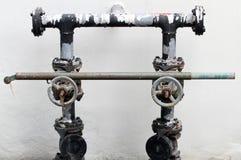 Alte und rostige Wasserleitung Stockbilder