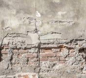 Alte vergipste Backsteinmauerbeschaffenheit Stockbild