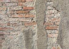 Alte vergipste Backsteinmauerbeschaffenheit Stockfotos