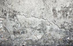Alte verwitterte Betonmauer mit Schäden Stockfotos