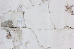 Alte verwitterte Betonmauerbeschaffenheit mit der Anzahl der Kratzer Lizenzfreies Stockfoto