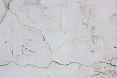 Alte verwitterte Betonmauerbeschaffenheit mit der Anzahl der Kratzer Stockfotos