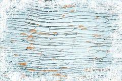 Alte verwitterte hölzerne Planke gemalt in der blauen Farbe, hölzerne Beschaffenheitswand mit Schneeeffekt-Weihnachtshintergrund stockbild