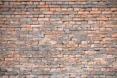 Alte verwitterte orange Backsteinmauerbeschaffenheit Stockfoto