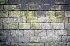 Alte verwitterte raue Sandstein-Backsteinmauer Stockfoto