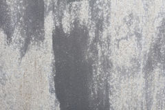 Alte Wand Beschaffenheitsmetalltür es wurde in dunkelgrauem gemalt helle Abnutzung Stockfotografie