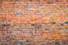 Alte Wand des roten Backsteins Stockfotografie
