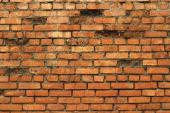 Alte Wand des roten Backsteins Stockfoto