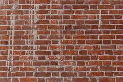 Alte Wand des roten Backsteins in einem Hintergrund Stockfoto