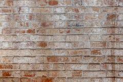 Alte Wand des roten Backsteins in einem Hintergrund Lizenzfreies Stockbild