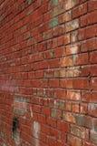 Alte Wand des roten Backsteins in einem Hintergrund Alte Backsteinmauer weinlese Stockfotografie
