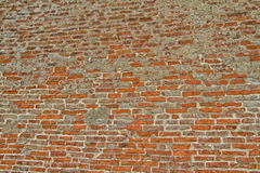 Alte Wand des roten Backsteins und des Graus Lizenzfreie Stockbilder