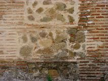 Alte Wand des roten Backsteins und des Steins für den Hintergrund Ihrer Fotos Stockfotografie
