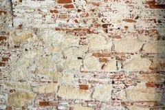 Alte Wand des Ziegelsteines und des Steins Stockfoto