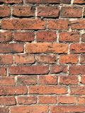 Alte Wand hergestellt von den roten Backsteinen Stockfotografie