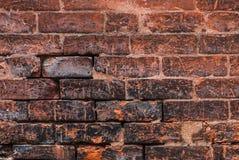 Alte Wand-Hintergrundbeschaffenheit des roten Backsteins Lizenzfreie Stockbilder