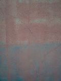 Alte Wand maserte Oberfläche mit Kratzern im blauen und orange Ton Lizenzfreie Stockfotografie