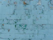 Alte Wand mit gemaltem und schäbigem ungleichem Gips Gebrochener Backsteinmauer-Hintergrund Weinlese-Maurerarbeit-Struktur mit ab Stockbild