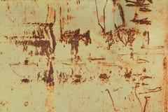 Alte Wand mit rostigen Stellen und alte Aufschriften entziehen Sie Hintergrund Stockfotografie