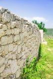 Alte Wand mit Steinen Lizenzfreie Stockfotos