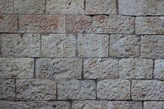 Alte Wand von beige Blöcken der Jerusalem-Steinbeschaffenheit Lizenzfreies Stockfoto
