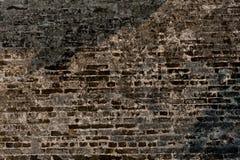 Alte Wand von schwarzen briks, Hintergrund Lizenzfreie Stockfotos