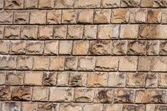 Alte Wand zeichnete mit einem Stein der braunen Farbe Stockfotos